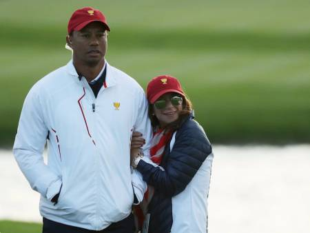 Tiger Woods with his girlfriend, Erica Herman