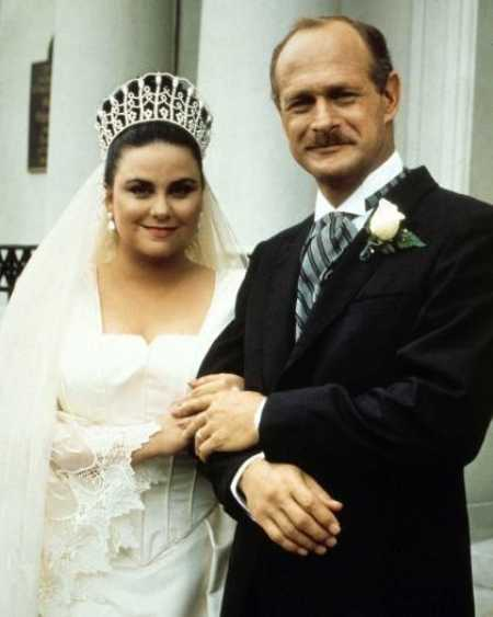 Delta Burke and Gerald McRaney at their wedding ceremony. Want to know more about their wedding details.