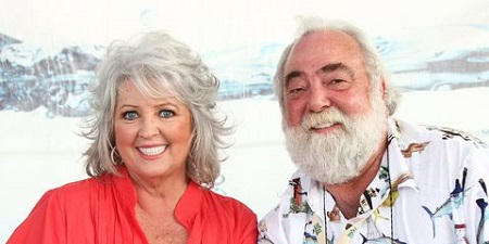 Paula posing with her husband Michael