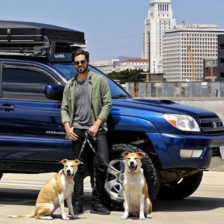 Chris with his two pet dogs