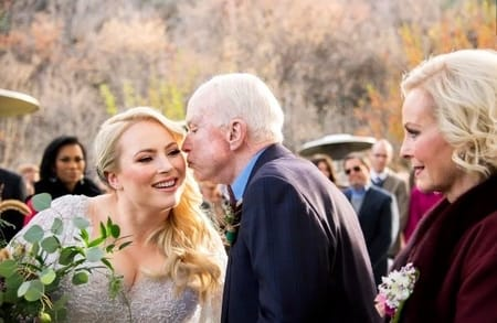 Meghan with her father John McCain and mother during her wedding