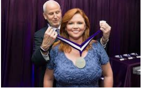 Caption: J.David Ake And His Wife Kelly O'Donnell Having An Honorable Medal For Her Work Source: answersafrica