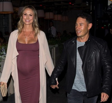 Stacy Keibler's adding a new members to her family.