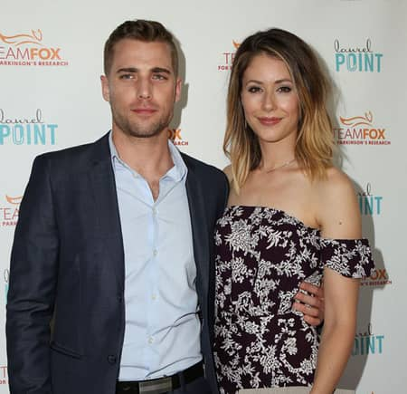 Amanda Crew and Dustin Milligan posing for the Paparazzi Pictures