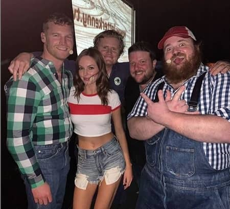 Jared Keeso with his co-actors of Letterkenny