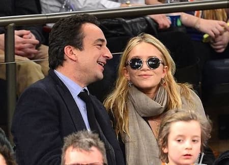 Mary Kate Olsen and Olivier enjoying an event while they were together
