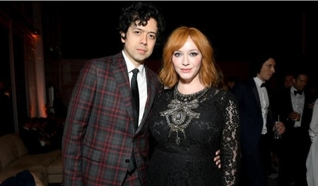 Geoffrey and Christina Hendricks attending the party