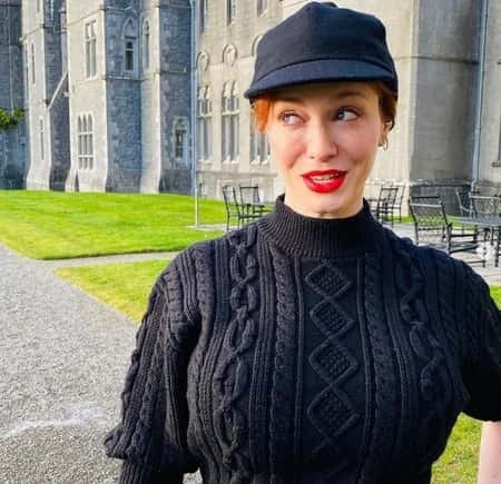 Christina Hendricks in front of a 800-year-old Castle after the divorce with her husband Geoffrey Arend