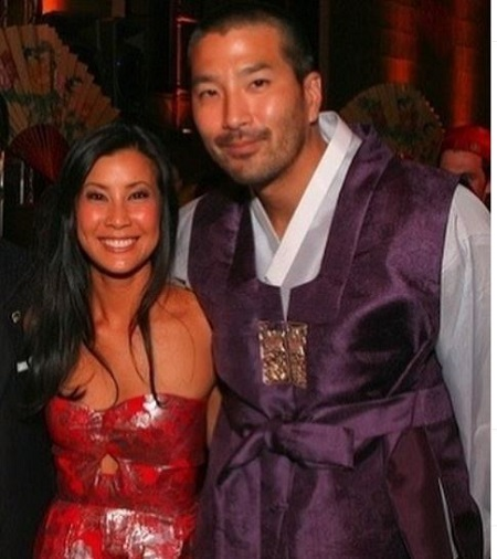 Lisa Ling was looking gorgeous on her strapless red wedding gown (dress).