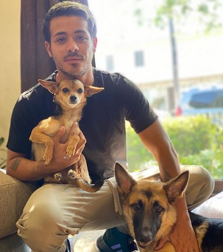 The actor Christian Navarro with his two pet dogs.