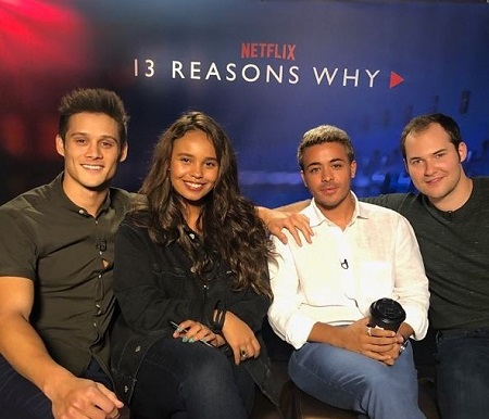 The actor Christian Navarro (white shirt) with the 13 Reasons Why cast Alisha Boe (actress), Timothy Granaderos (actor left), and Jay Asher (novelist right).