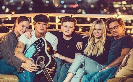 Angie Simpson with her husband Brad (right) sons Cody Simpson (second from left), Tom Simpson (middle) and daughter Alli Simpson (second from right).