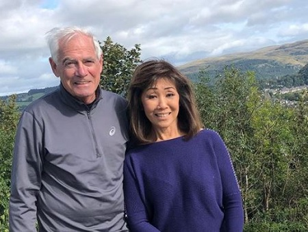 The retired journalist Linda Yu shares a picture with a man named Stuart.