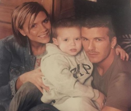 The childhood image of Brooklyn Beckham with his celebrity parents David Beckham and Victoria Adams Beckham.