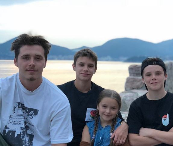 Brooklyn Beckham (white T-shirt) with his elder siblings, Romeo James, Cruz David (brother), and Harper Seven (sister).