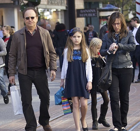 Janice Crystal And Billy Crystal's Walking Together With Their Grandaughters, Ella and Dylan Foley