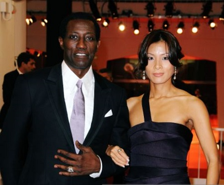 "Wesley Snipes and Nakyung ""Niki"" Park attend the premier"