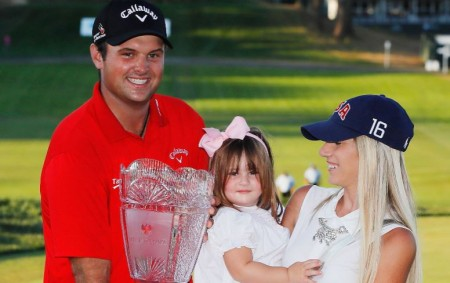 Patrick Reed poses with his wife Justine and their daughter Windsor-Wells after winning The Barclays in 2016.