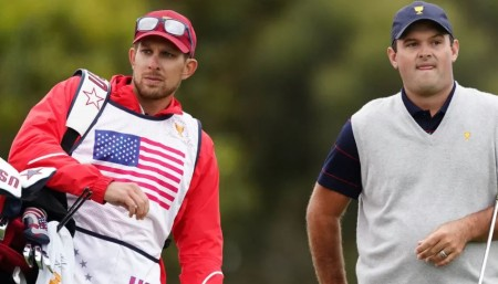 Kessler Karain works as the caddie of his brother-in-law.